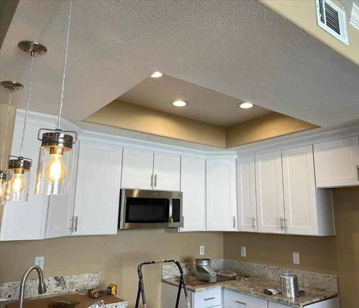 white kitchen cabinets sink and lights